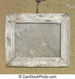 Old wooden picture frame on the wall texture. Template for...