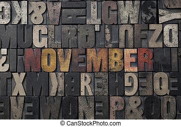 November - The word November written in antique letterpress...