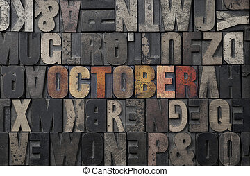 October - The word October written in antique letterpress...