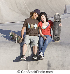 Kids at skatepark - Two kids hang out at the skatepark