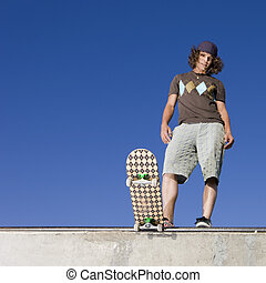 Skater at halfpipe - Skateboarder at top of half pipe
