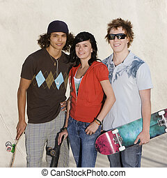 Teens at the skatepark - Three kids hang out at the skate...
