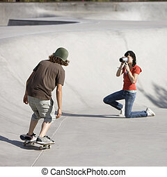 Videotaping skateboard action - Boy dies tricks at the...