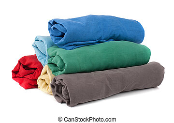 Stack of rolled clothes - Stack of rolled clean clothes over...