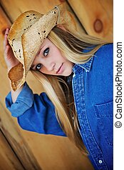 Blond Model with Cowboy Hat - Attractive Blond Model Peers...