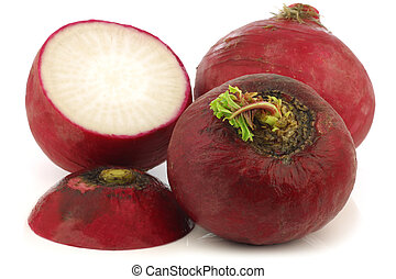 big red radishes and a cut one - fresh big red radishes and...