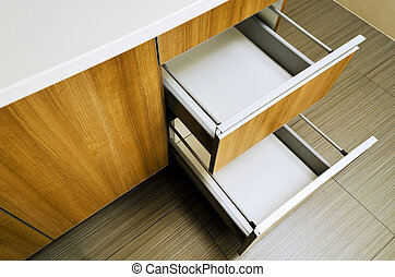 Kitchen Drawer - Open and empty kitchen drawers shot from...