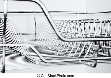 Stainless Rack - Close-up of stainless steel dish rack...