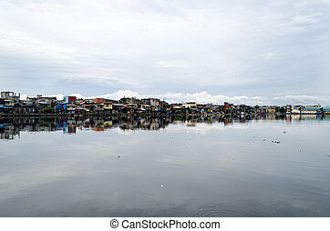 Malabon River - Rows of houses along the Malabon River in...