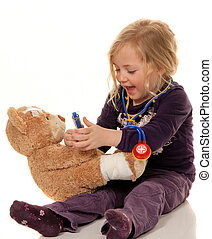 child with stethoscope as a doctor pediatrician examined...
