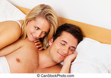 couple has fun in bed laughter, joy and eroticism in the...