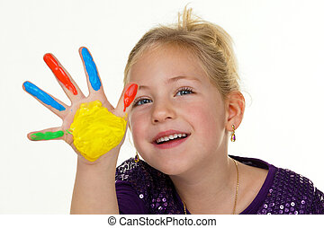 child painting with finger paints - a small child with...