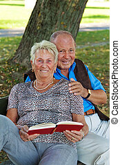 mature senior couple is in love man handed a rose