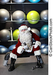 Santa Claus in gym - Santa Claus working out in fitness...
