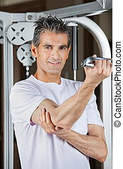 Mature Man Working Out In Fitness Center - Portrait of...