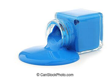 glass jar spilling cyan paint