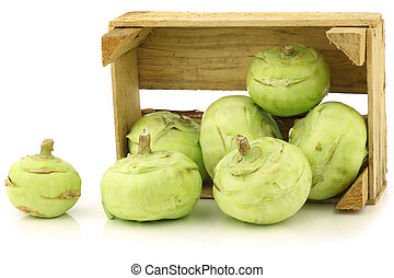 kohlrabi cabbages - Freshly harvested kohlrabi in a wooden...