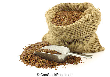 Flax seed (linseed) in a burlap bag with an aluminum scoop...