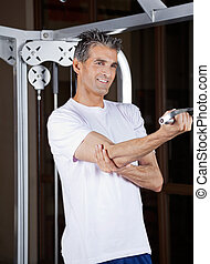 Man Working Out - Happy mature man working out in fitness...