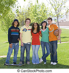 Teens hang out at park - Five teens hang out at park