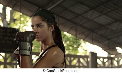 Woman exercising with trainer - Young woman at boxing and...