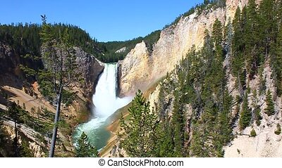 Lower Falls of the Yellowstone River illuminated in bright...