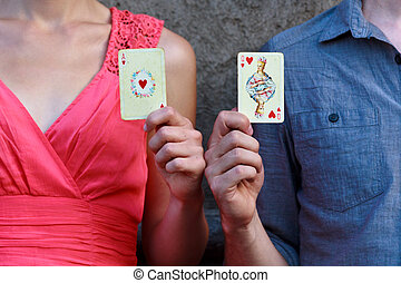Ace of hearts and queen of hearts - A couple showing an ace...