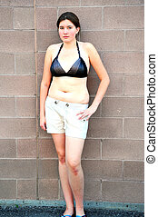 Full figured woman. - Full figured woman posing outside.
