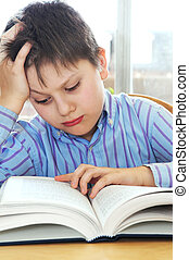 School boy studying - Serious school boy studying with a...