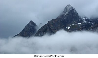 Teton Range Wyoming - Dense clouds move along the Teton...