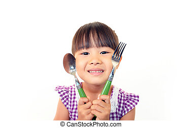 Child with a spoon and fork