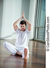 Young Man Practicing Yoga - Full length of a young man...