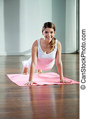 Young Woman Practicing Yoga - Portrait of a beautiful young...