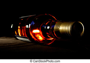 Whisky - Bottle of whisky on black crisp background