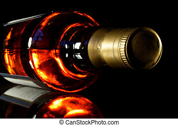 Whisky - Bottle of whisky with black crisp background