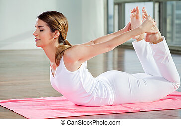Young Woman Practicing Yoga - Relaxed young woman practicing...