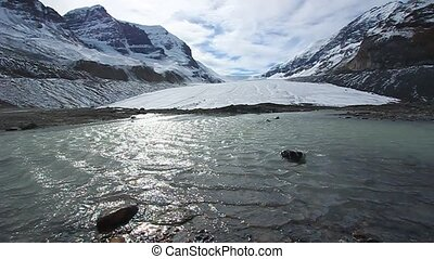 Athabasca Glacier Jasper Park - Cold winds blow down the...
