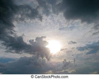 Evening sun shining through the clouds - Sun shining through...
