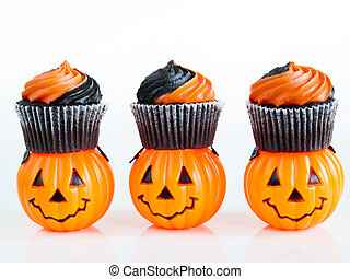Halloween Cupcakes - Halloween cupcakes decorated with black...