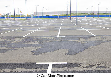 Empty parking area near supermarket