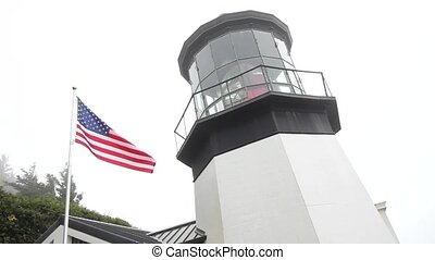 USA Flag Cape Meares Lighthouse - USA Flag Flying next to...