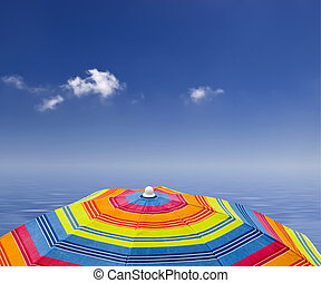Tropics - Beach parasol against blue sky and ocean