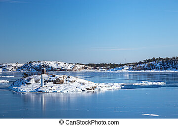 Frozen sea and islands - Small islands in the sea in winter...