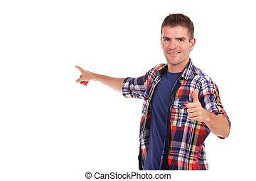young man presents something with thumb up