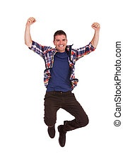 young happy man is jumping in air - Picture of an ecstatic...