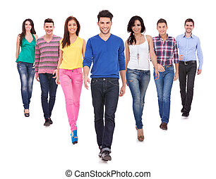 young casual people walking forward - Large group of...