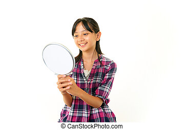 Smiling girl with a mirror