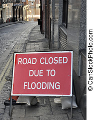 Flooding sign - Closeup of flooding sign on street leading...