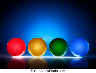 Illuminated color plastic balls, blue light background