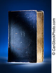 Old book, mystical blue light background